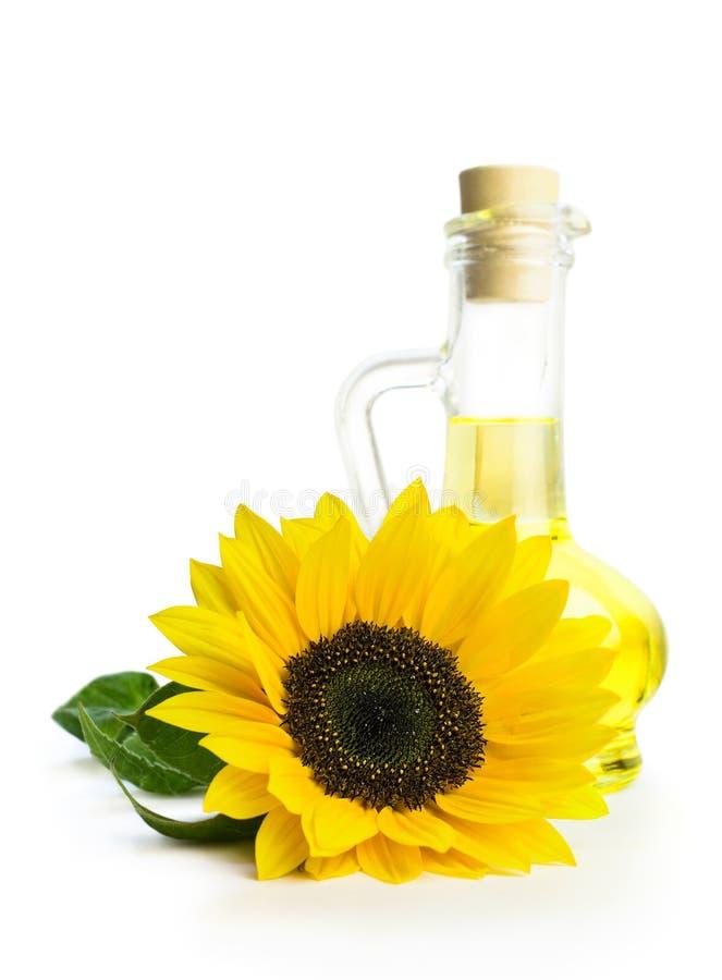 有向日葵油和向日葵的玻璃瓶 库存照片