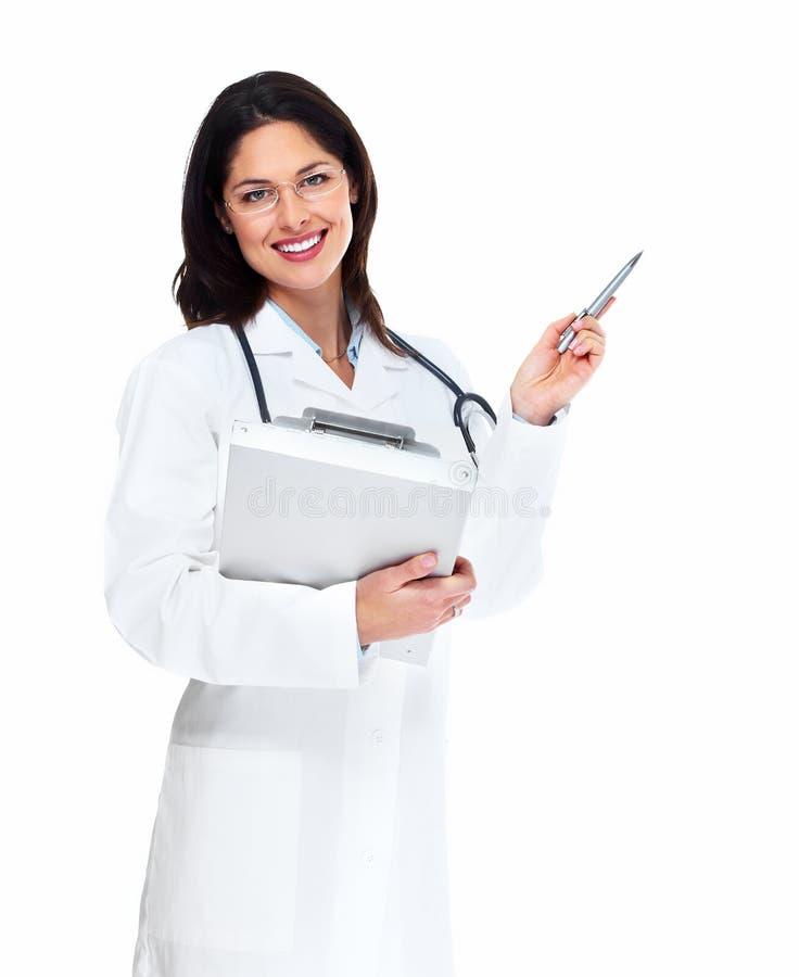 有听诊器的微笑的医生妇女。 免版税图库摄影