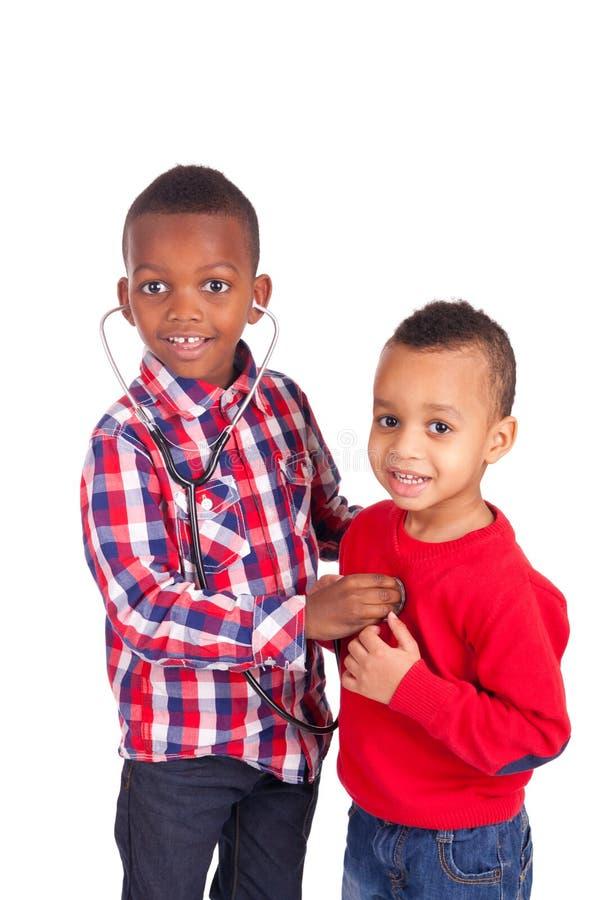 有听诊器的黑人非裔美国人的孩子 库存照片