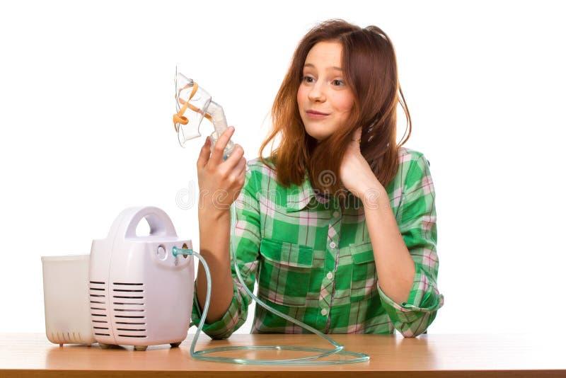 有吸入器的妇女 库存图片