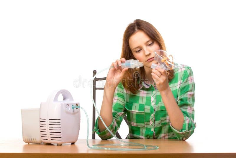 有吸入器的妇女 图库摄影