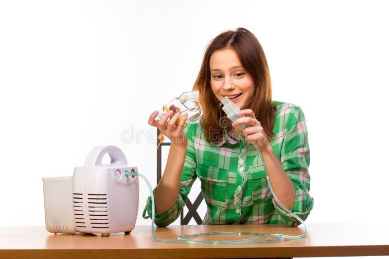 有吸入器的妇女 库存照片