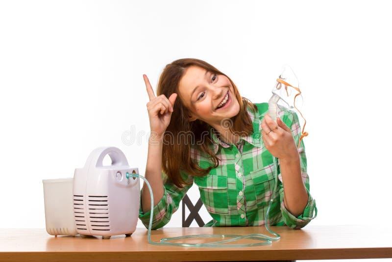 有吸入器的妇女 免版税库存图片