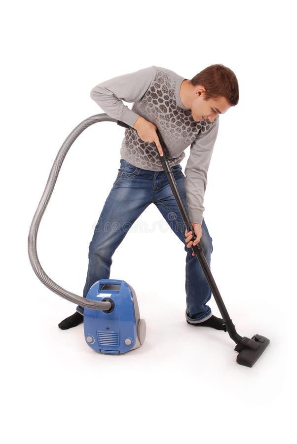 有吸尘器的男孩 免版税库存照片