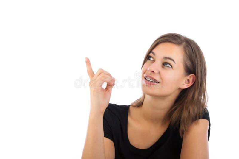 有吸引力愉快少妇指向 库存照片