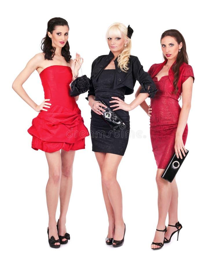 有吸引力摆在三名妇女 免版税库存照片