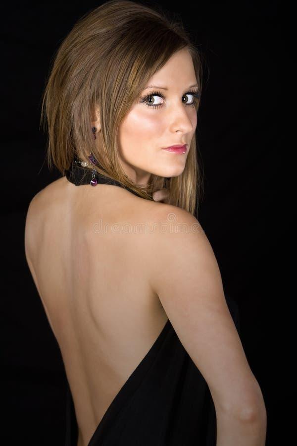 有吸引力查找在肩膀的她青少年 免版税图库摄影