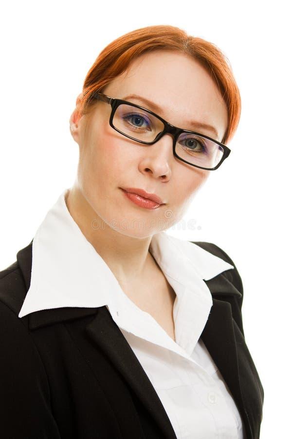 有吸引力的企业玻璃头发的红色妇女 免版税库存照片