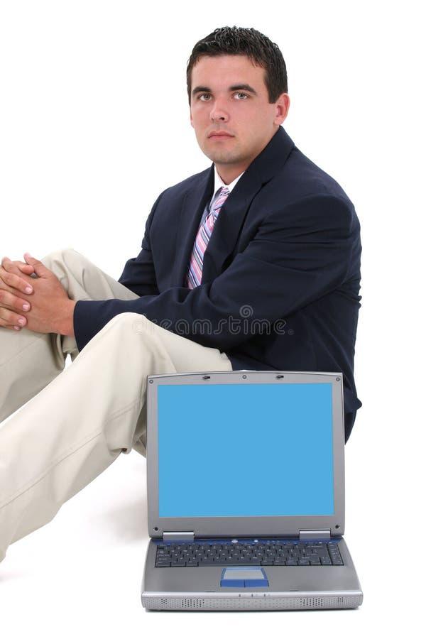 有吸引力的后面商人坐的年轻人 免版税库存图片