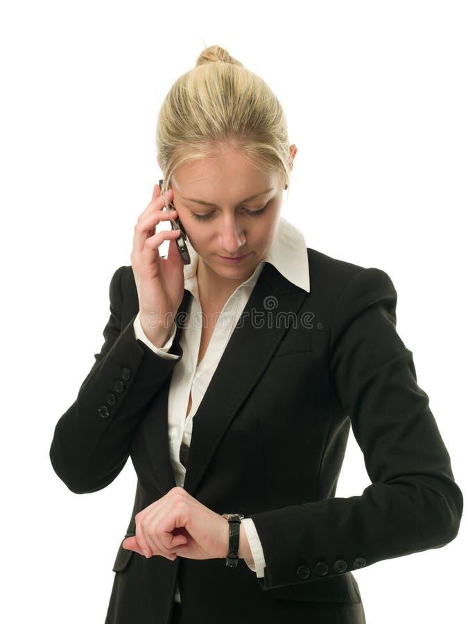 有吸引力的女实业家移动电话 免版税库存图片