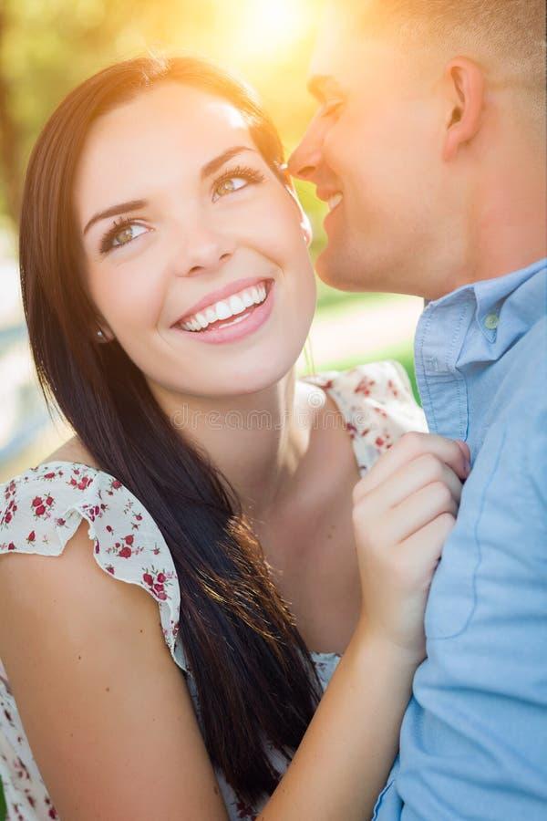 有吸引力的愉快的混合的族种浪漫夫妇画象在公园 库存照片