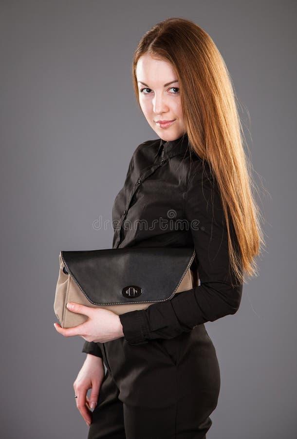 有吸引力的手袋妇女年轻人 库存照片