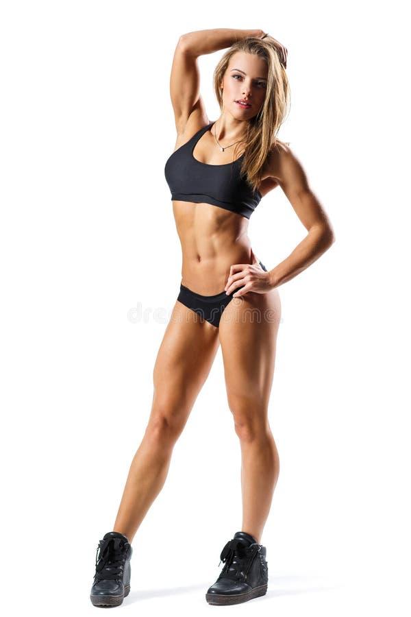 有吸引力的照相机特写镜头健身增强的微笑衡量妇女 库存图片