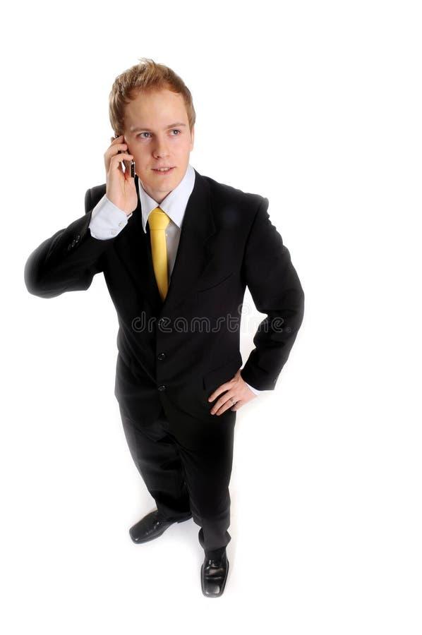 有吸引力的生意人电话 库存照片