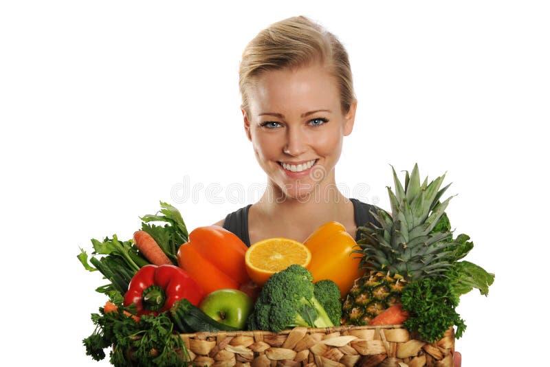 有吸引力的白肤金发的果子妇女年轻人 免版税图库摄影