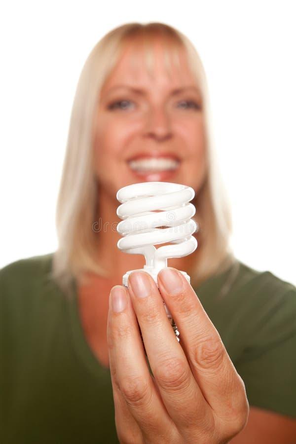 有吸引力的白肤金发的能源拿着轻的&# 库存图片