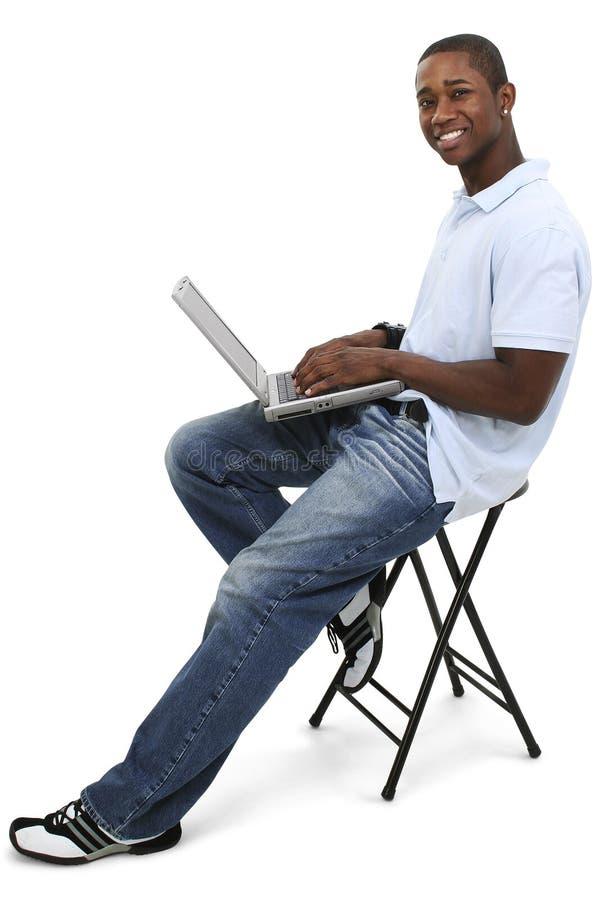 有吸引力的计算机膝上型计算机人年轻人 免版税库存图片