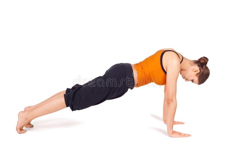 有吸引力的适应姿势实践的女子瑜伽 免版税库存图片