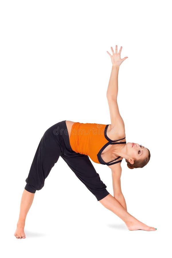 有吸引力的适应姿势实践的女子瑜伽 库存图片