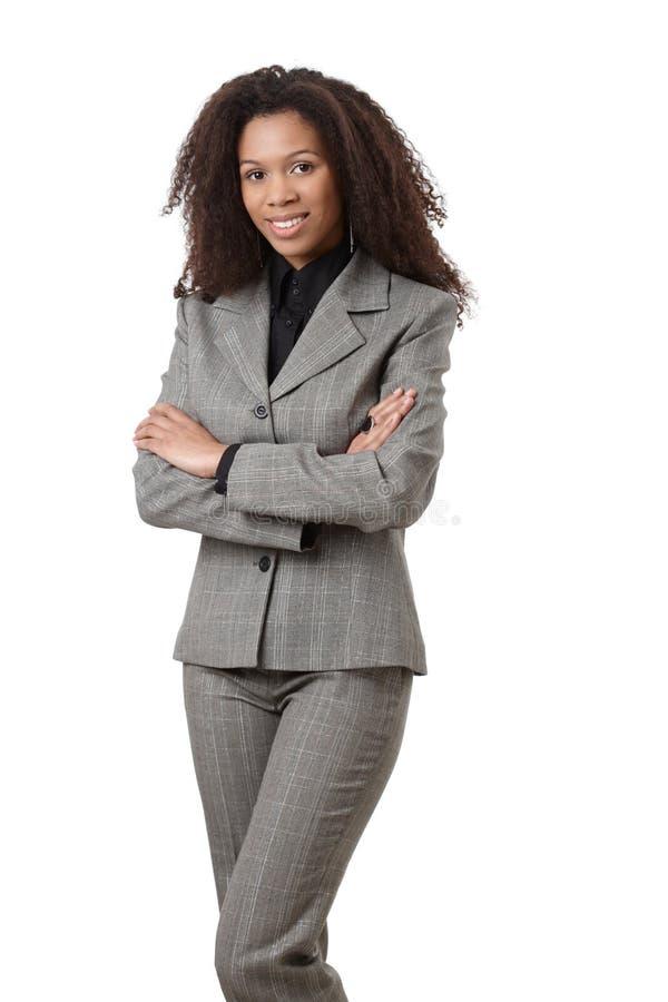 有吸引力种族女实业家微笑 库存图片