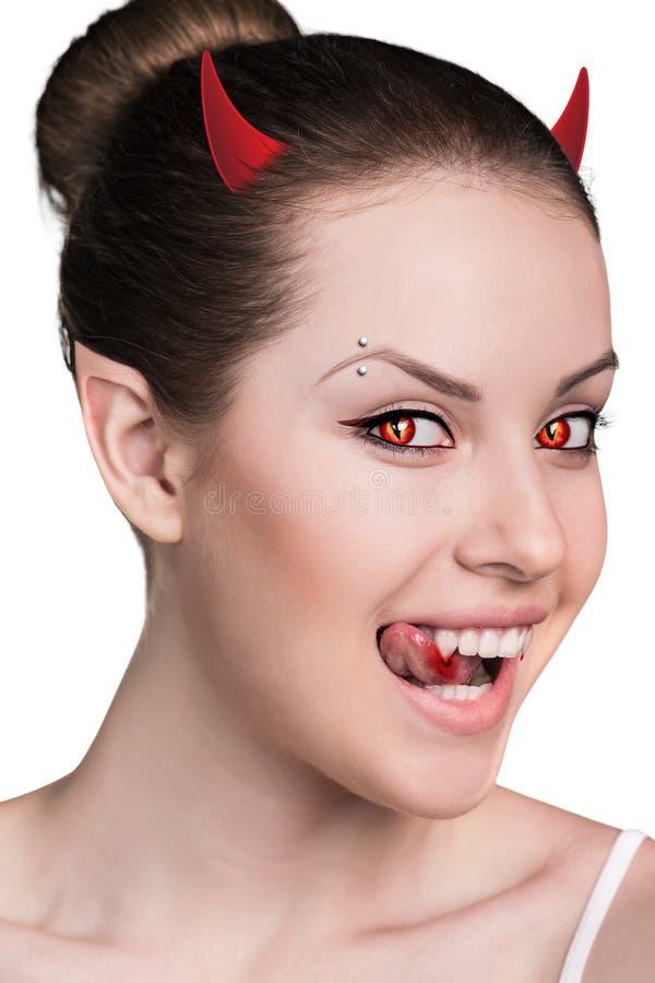 有吸血鬼犬齿的妇女 免版税库存照片