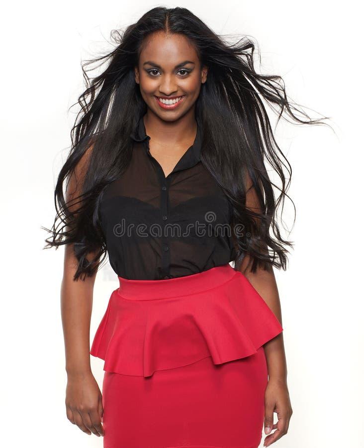 有吹的头发的美丽的混合的族种女孩 库存图片