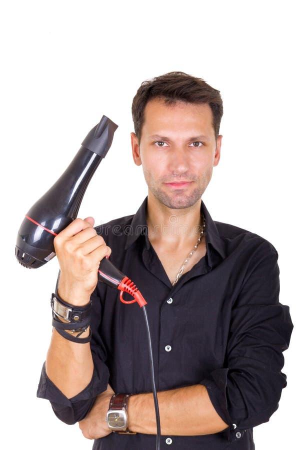 有吹风器的男性理发师 图库摄影