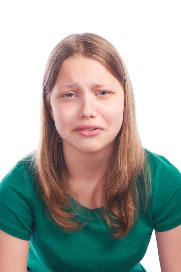 有哀伤的面孔的青少年的女孩 免版税图库摄影