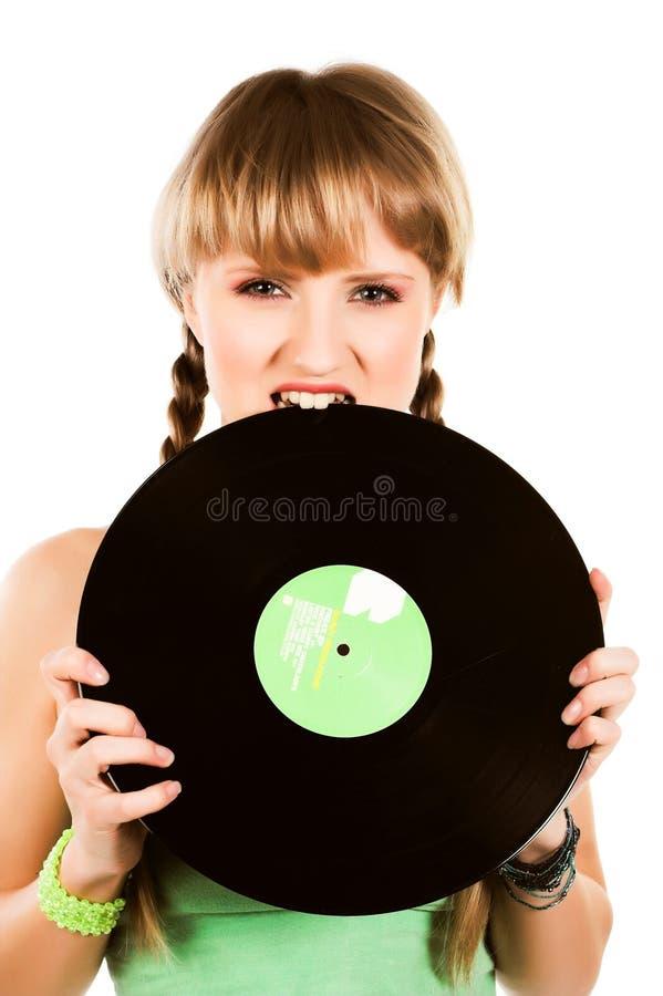 有唱片的嬉戏的白肤金发的女孩 库存图片