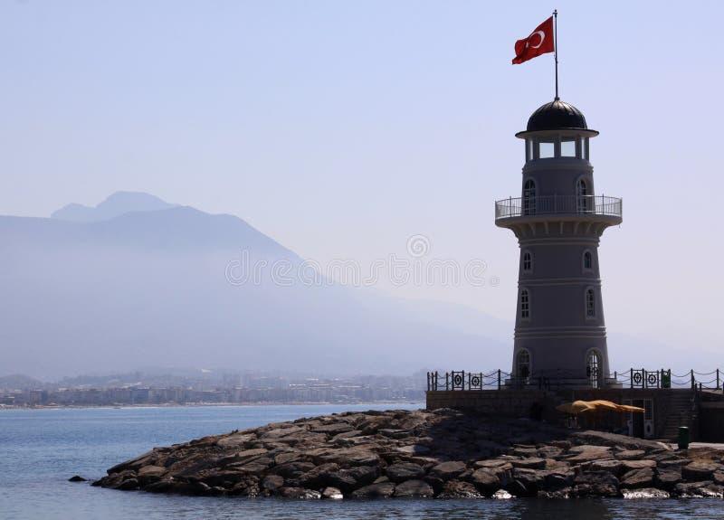 有土耳其旗子的灯塔 库存照片