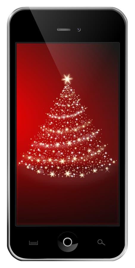 有圣诞树的手机 免版税库存图片
