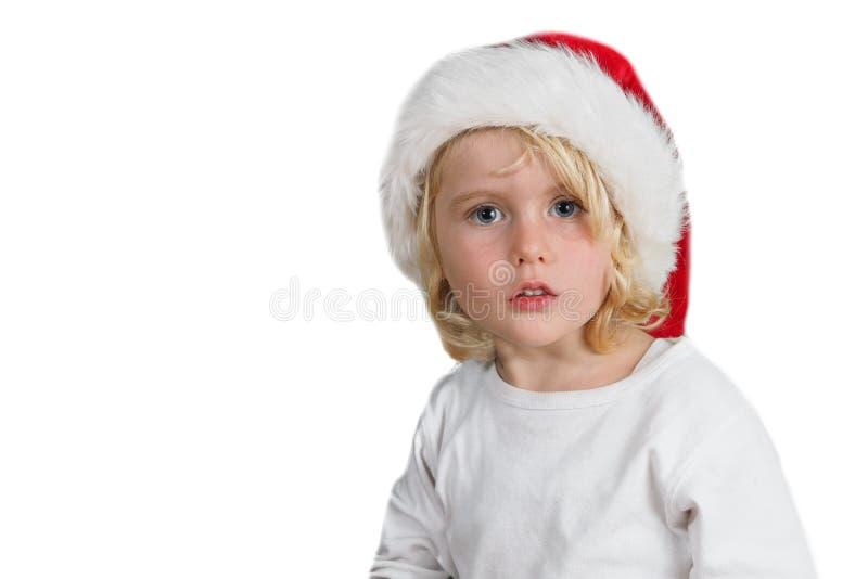 有圣诞老人帽子的圣诞节小女孩 库存照片