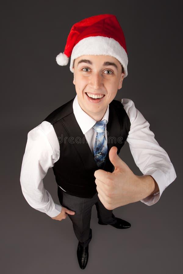 有圣诞老人帽子的年轻人 库存图片