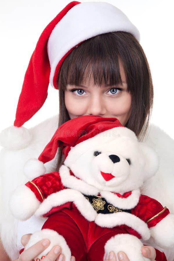 有圣诞节北极熊的女孩 免版税库存照片
