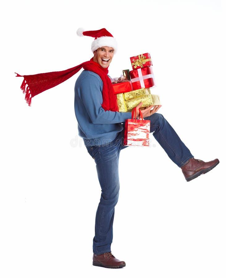 有圣诞节礼物的愉快的人。 库存图片