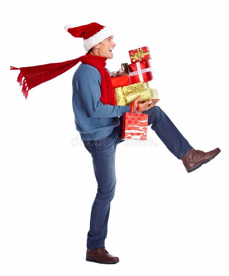 有圣诞节礼物的愉快的人。 免版税库存图片