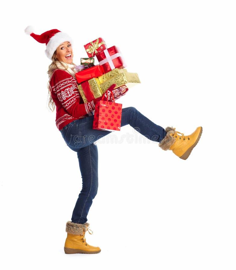 有圣诞节礼物的愉快的妇女。 库存照片