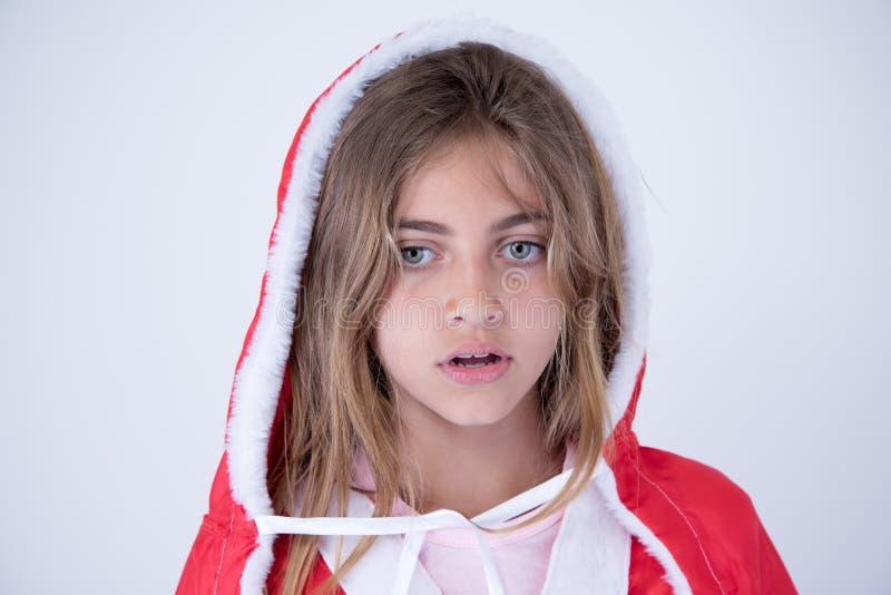 有圣诞节神色的小女孩 免版税库存照片