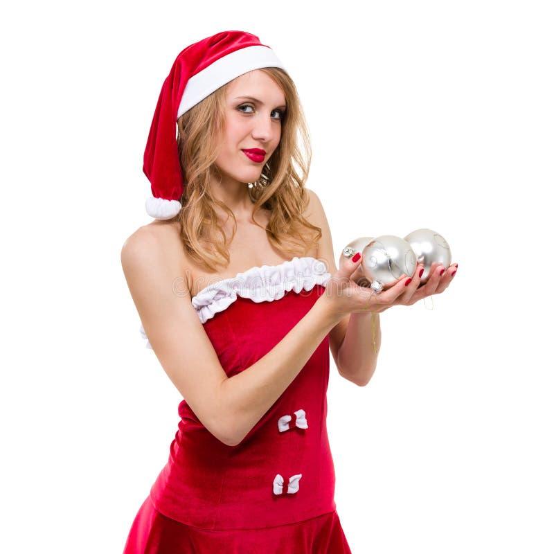 有圣诞节装饰的美丽的年轻微笑的妇女反对被隔绝的白色 免版税图库摄影