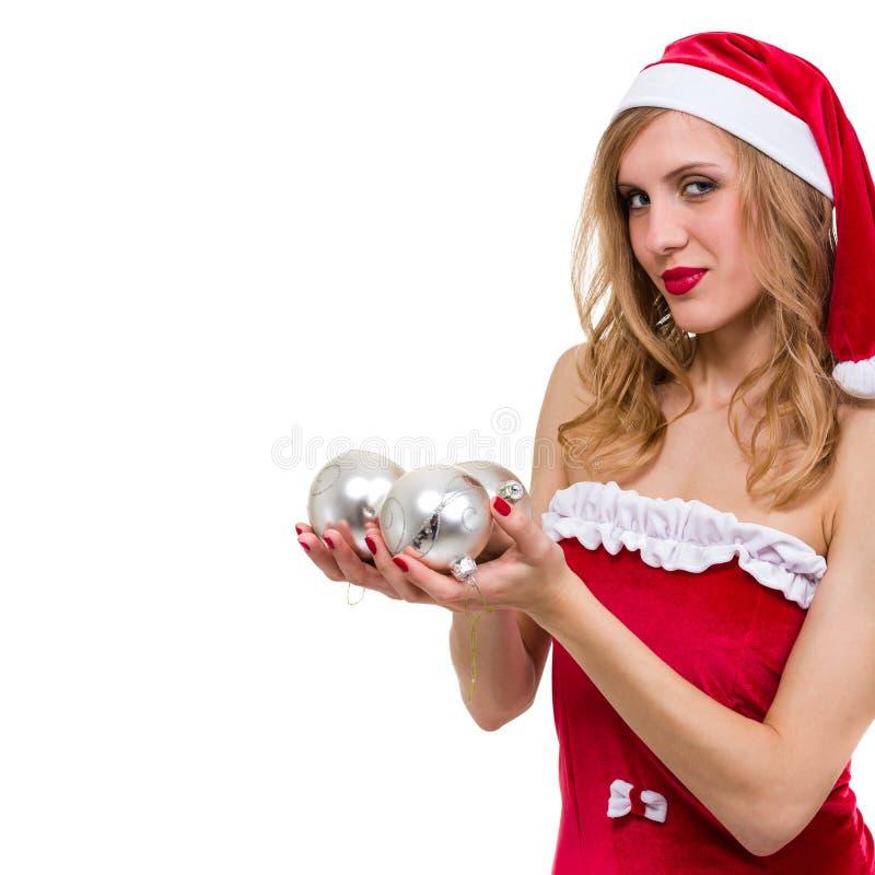 有圣诞节装饰的美丽的年轻微笑的妇女反对被隔绝的白色 库存照片