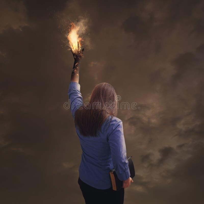 有圣经的灼烧的手 免版税库存图片