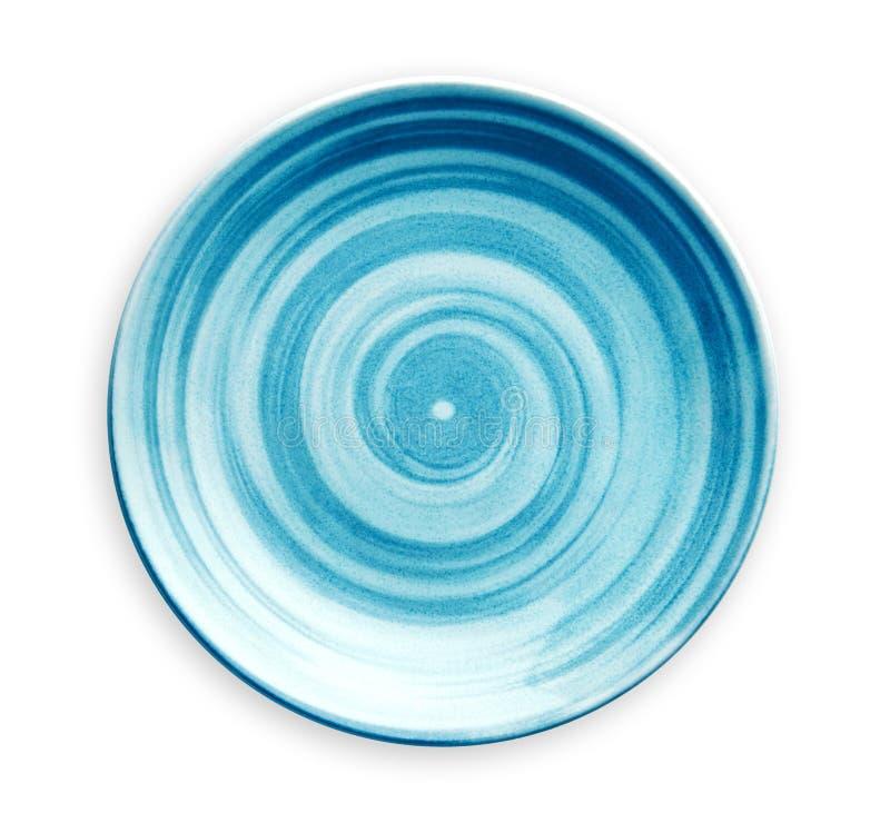 有在与裁减路线的白色背景在水彩样式,看法空的蓝色陶瓷板材从上面隔绝的螺旋样式的 库存图片