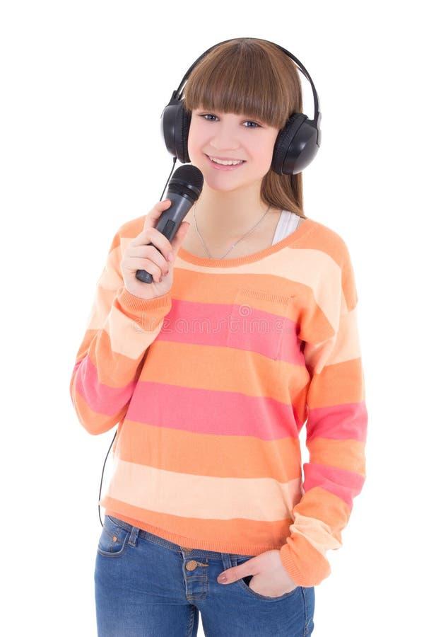 有在白色和话筒的十几岁的女孩隔绝的耳机 免版税图库摄影