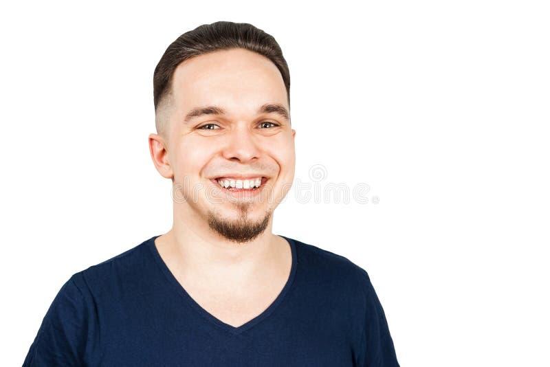 有在白色背景和牙的帅哥隔绝的宽白色甚而微笑 库存照片