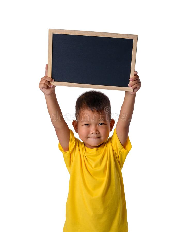 有在白色背景教育概念性的隔绝的空白的黑黑板的亚洲国家男孩 库存照片