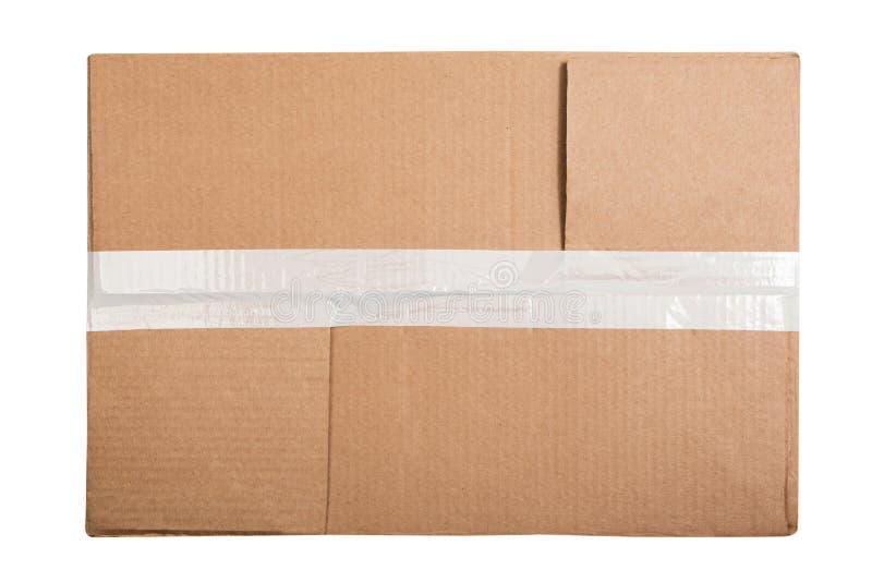 有在白色背景隔绝的一卷稠粘的磁带的长方形纸板箱 平的位置 免版税库存图片