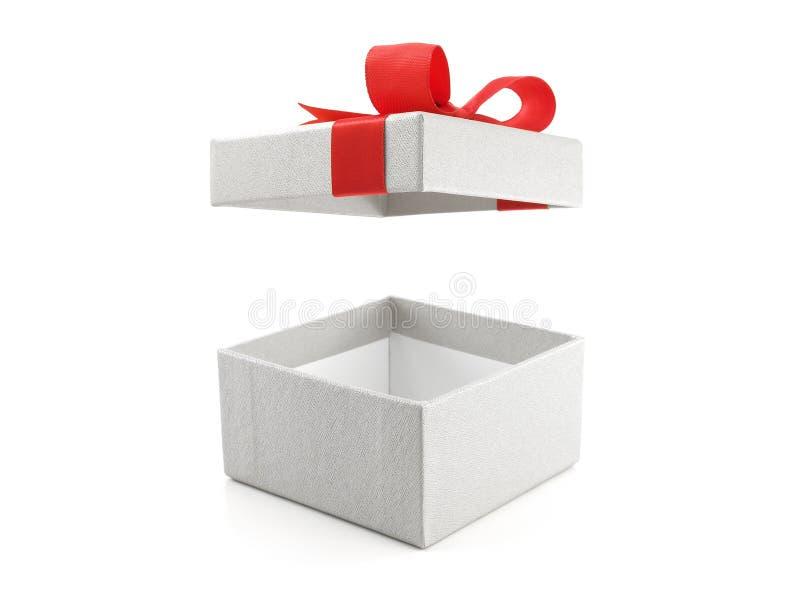 有在白色背景隔绝的红色丝带弓的开放和空的白色礼物盒 库存图片