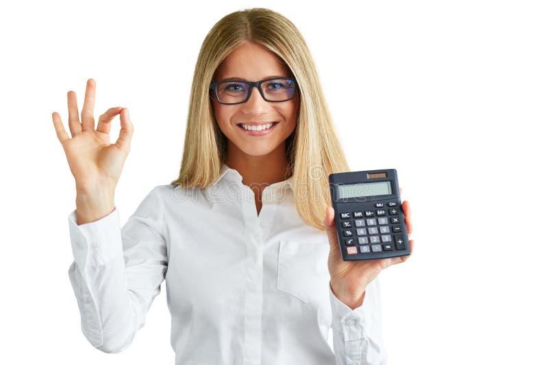 有在白色背景隔绝的计算器的妇女 免版税库存照片