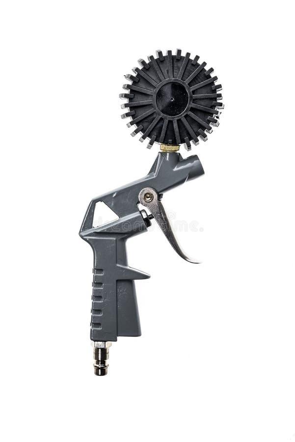 有在白色背景隔绝的测压器的空气压缩机枪 免版税图库摄影