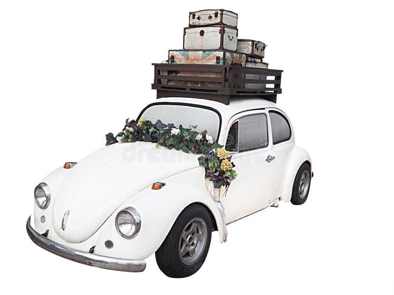 有在白色背景-隔绝的花的婚姻的汽车 免版税库存图片